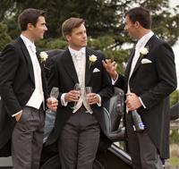 Men in formal wear talking
